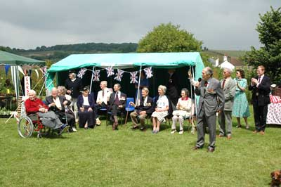 Colonel Jimmy Evans opens the Fête along with Froyle's World War Two veterans.